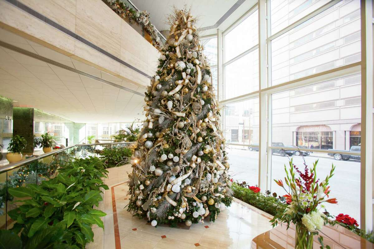 Every holiday, seasonal and event designer Regina Gust fills the lobby of the downtown Houston's Lyric Centre with a 20-foot tree.