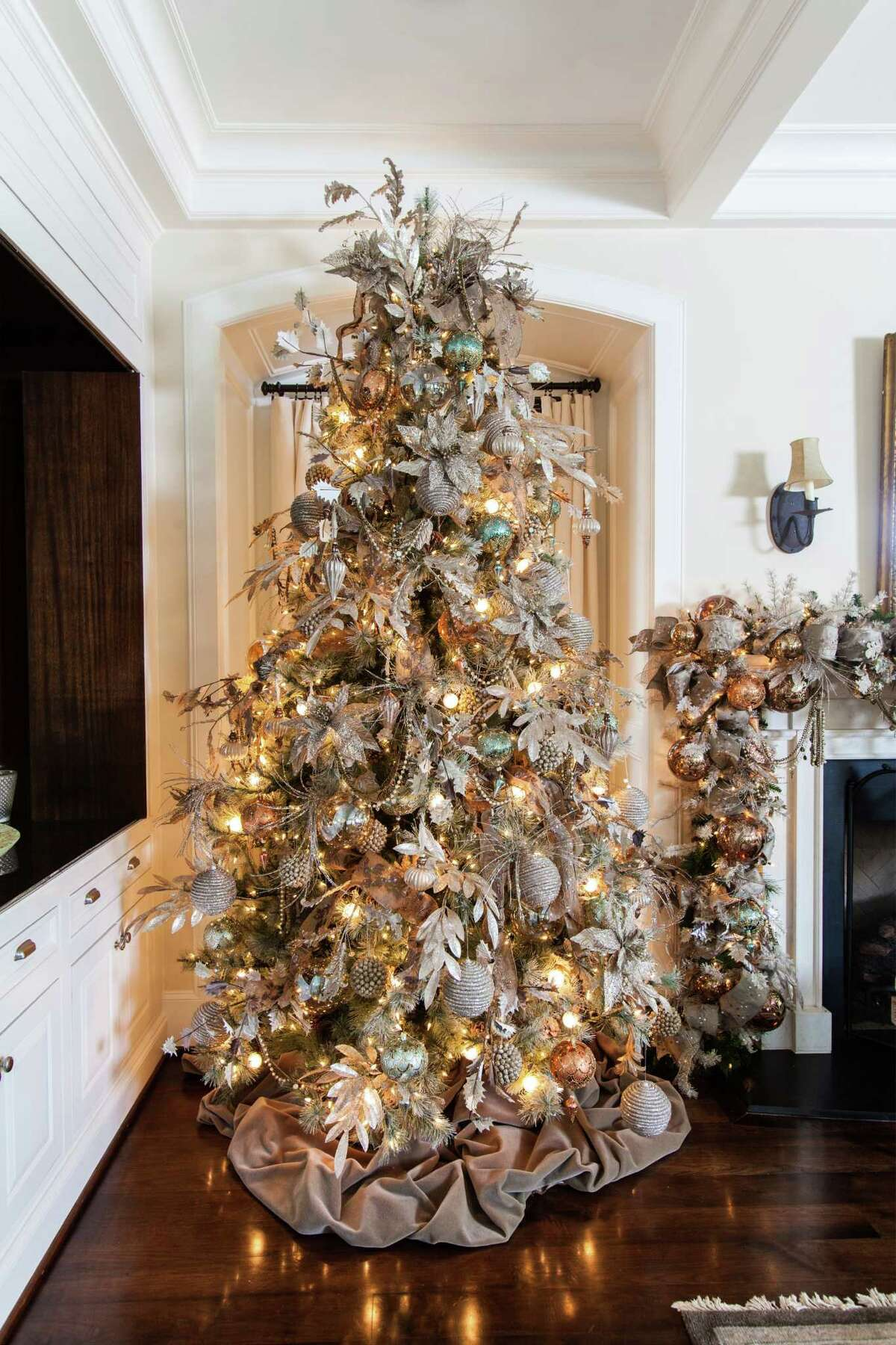 In this West University home's family room, Gust decorated the tree with blush tones, bronzes and soft greens.