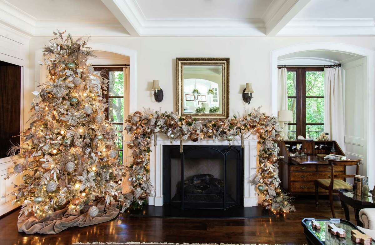 The mantel is draped with a garland that picks up the soft colors Gust used on the tree.