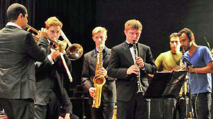 Greenwich High School student Peter Russell, on clarinet, performs along with GHS bandmates and members of Yasek Manzano's trumpet band during a trip to Cuba in April.