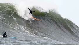 """Ocean Beach-based surfer Bianca Valenti takes off on a wave. Valenti said of the event, """"There was good energy. It was totally empowering."""""""