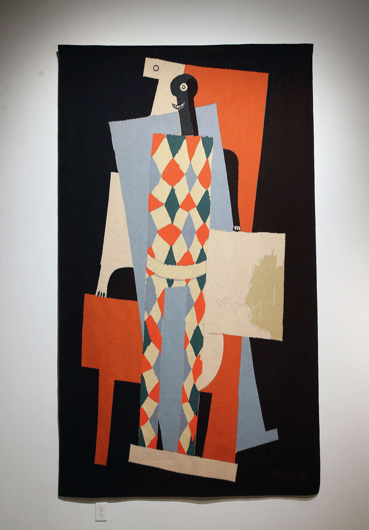 """""""After Harlequin"""" is displayed as the San Antonio Museum of Art is hosting an exhibition of 15 large scale tapestries of works by Picasso commissioned by Nelson Rockefeller on December 17, 2014."""