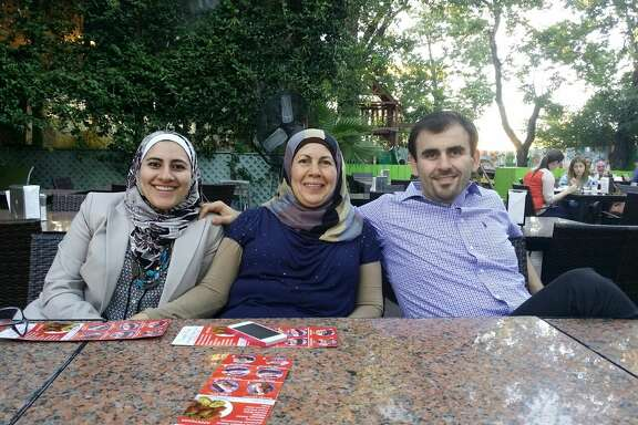 Judy Ghashim, left; Bader Ghashim, right; and their mother, center.