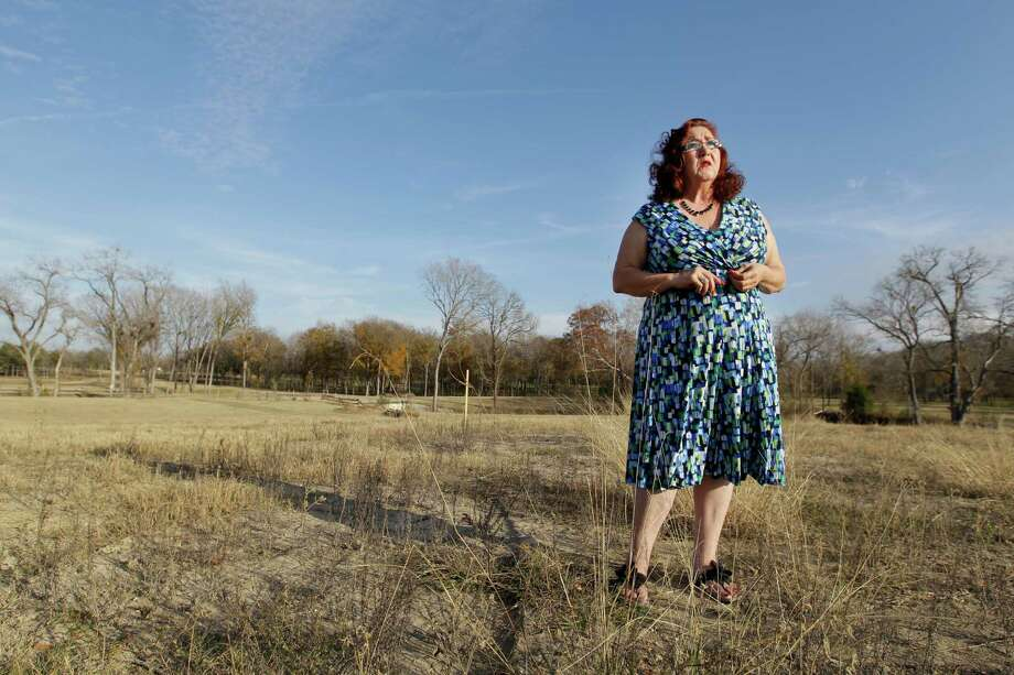 Nancy Perry, shown here Dec. 4, 2014, was planning a home on 10 acres outside Navasota. Now a proposal to run two transmission lines nearby - one would be only 900 feet from her front porch - have halted the Grimes County real estate broker's plans to build. Photo: Melissa Phillip, Staff / © 2014  Houston Chronicle