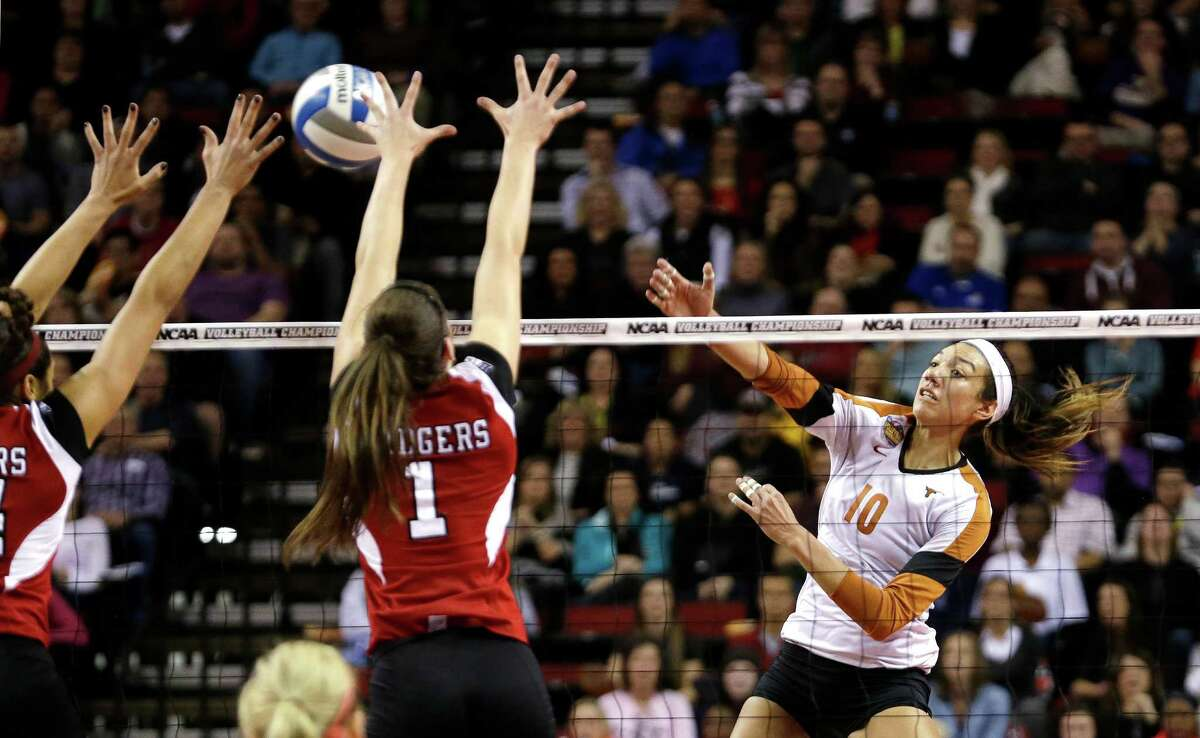 Texas' Haley Eckerman (10) puts up a shot against Wisconsin in an NCAA women's volleyball tournament semifinal Thursday, Dec. 19, 2013, in Seattle.
