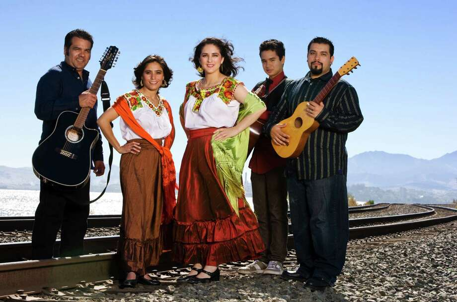 The East Bay band Los Cenzontles celebrates its 25th anniversary at Yoshi's on Jan. 8 with David Hidalgo of Los Lobos, with whom the group has made five recordings. Photo: Courtesy Of Los Cenzontles / ONLINE_YES
