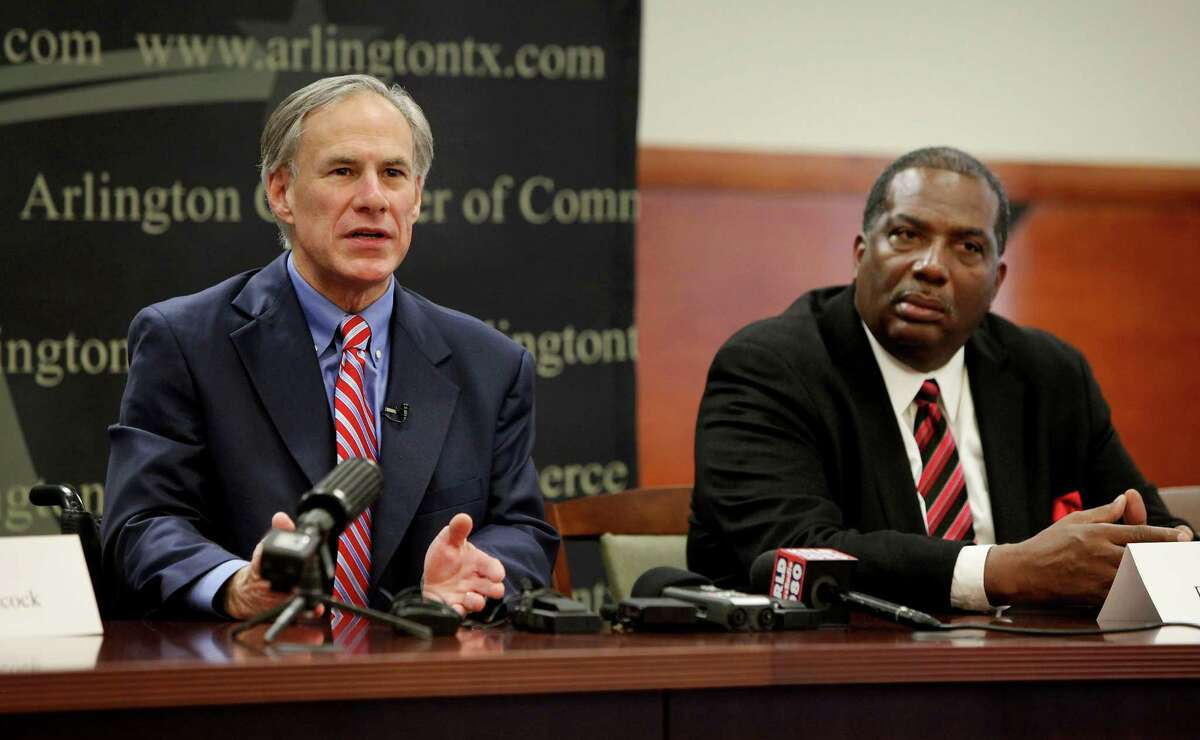 Texas Gov.-elect Greg Abbott, left, speaks as Rep. Royce West listens during a roundtable discussion with local lawmakers at the Arlington Chamber of Commerce in Arlington, Texas on Tuesday, Dec. 16, 2014. (AP Photo/The Fort Worth Star-Telegram, Brad Loper) MAGS OUT; (FORT WORTH WEEKLY, 360 WEST); INTERNET OUT