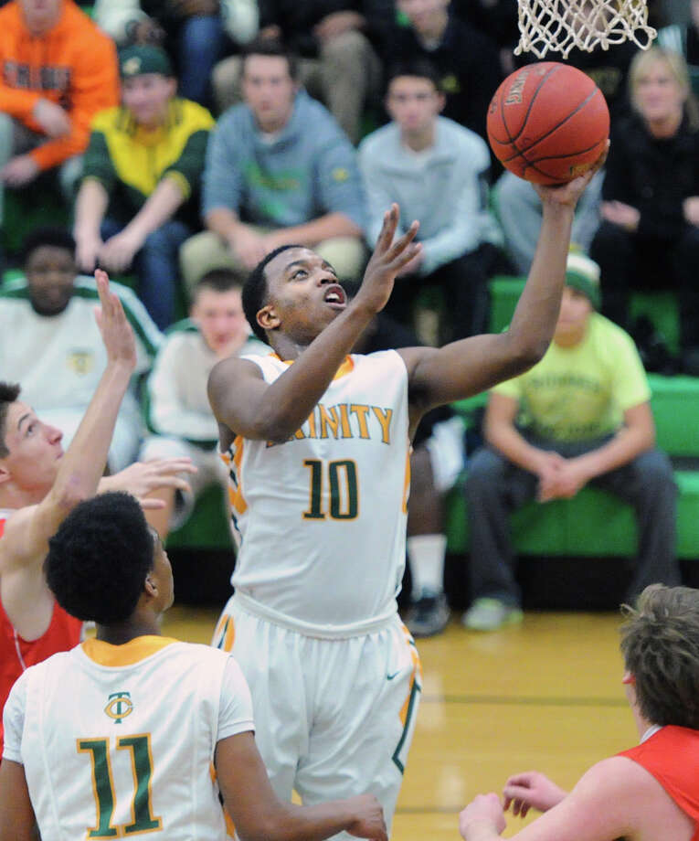 Tyrell St. John (#10) scores on a layup as teammate Justice Page (#11) looks on during the boys high school basketball game between Trintiy Catholic High School and Greenwich High School at Trinity in Stamford, Conn., Wednesday, Dec. 17, 2014. Photo: Bob Luckey / Greenwich Time