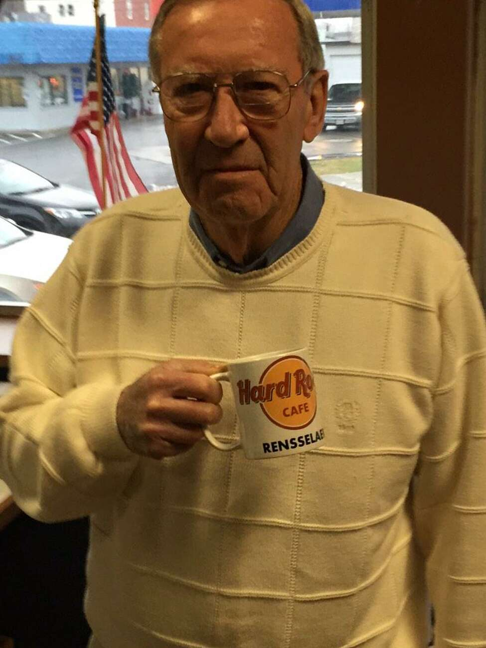 Rensselaer Mayor Dan Dwyer holds his Hard Rock Cafe mug at city hall in advance of the state Gaming Commission Siting Board's announcement of its recommendations for casino sites on Dec. 17, 2014. (Kenneth C. Crowe II/Times Union)