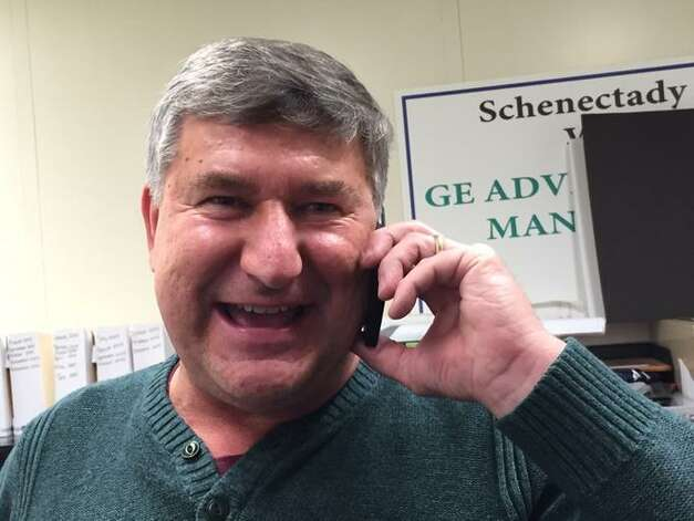 Schenectady City Councilman Ed Kosiur celebrates when the Gaming Facility Location Board selects Schenectady for a casino site on Dec. 17, 2014. (Cindy Schultz/Times Union)
