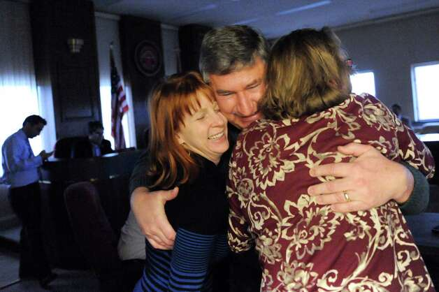 City Councilman Ed Kosiur, center, shares his joy with Julie McDonnell, city auditor and Niskayuna Town Councilwoman, left, and Patti Ellis, county auditor staff member, when the Gaming Facility Location Board selects Schenectady for a casino site on Wednesday Dec. 17, 2014, at the Schenectady County Office Building in Schenectady, N.Y. (Cindy Schultz / Times Union) Photo: Cindy Schultz / 00029889A