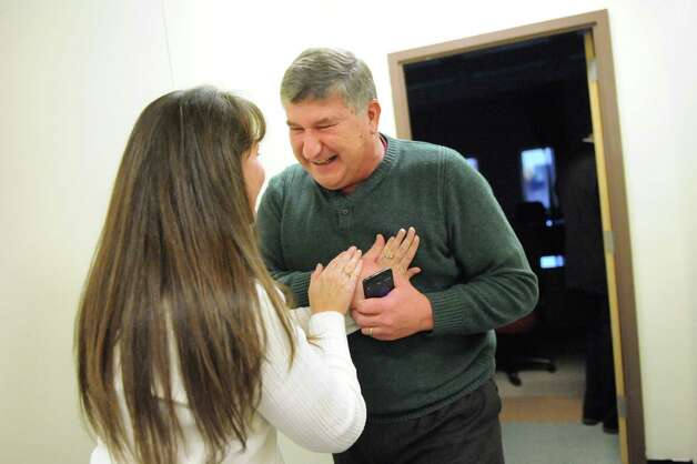 City Councilman Ed Kosiur, right, shares the fast beating of his heart with Kim Ambesi, county attorney office staff member, when the Gaming Facility Location Board selects Schenectady for a casino site on Wednesday Dec. 17, 2014, at the Schenectady County Office Building in Schenectady, N.Y. (Cindy Schultz / Times Union) Photo: Cindy Schultz / 00029889A