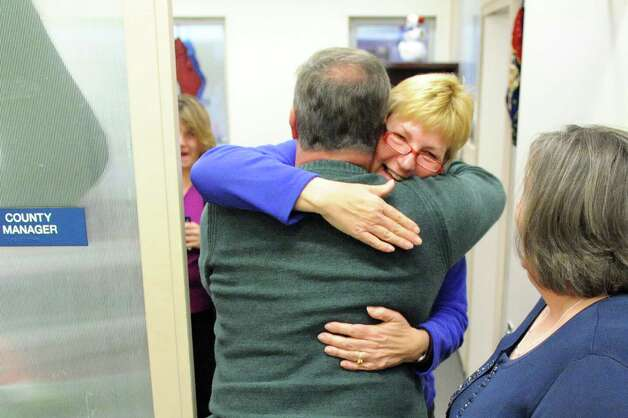 Executive secretary Belle Freedgood, center, hugs city councilman Ed Kosiur when the Gaming Facility Location Board selects Schenectady for a casino site on Wednesday Dec. 17, 2014, at the Schenectady County Office Building in Schenectady, N.Y. (Cindy Schultz / Times Union) Photo: Cindy Schultz / 00029889A