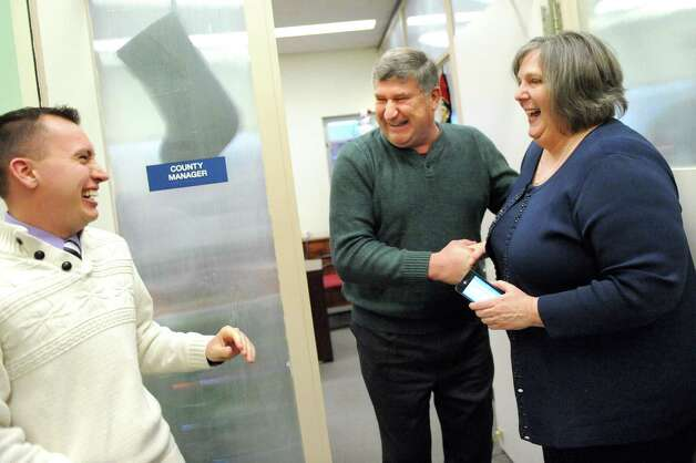 City councilman Ed Kosiur, center, celebrates with county intern Ryan Gregorie, left, and county manager Kathleen Rooney when the Gaming Facility Location Board selects Schenectady for a casino site on Wednesday Dec. 17, 2014, at the Schenectady County Office Building in Schenectady, N.Y. (Cindy Schultz / Times Union) Photo: Cindy Schultz / 00029889A