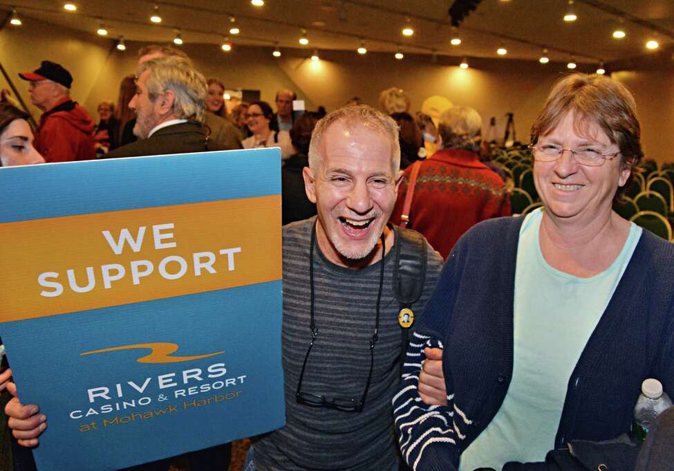 Schenectadians James Torre and Darlene Fordham, right, are all smiles after the announcement by the New York Gaming Facility Location Board that it had chosen Schenectady as a casino site during a meeting Wednesday Dec. 17, 2014, in Albany, NY. (John Carl D'Annibale / Times Union)