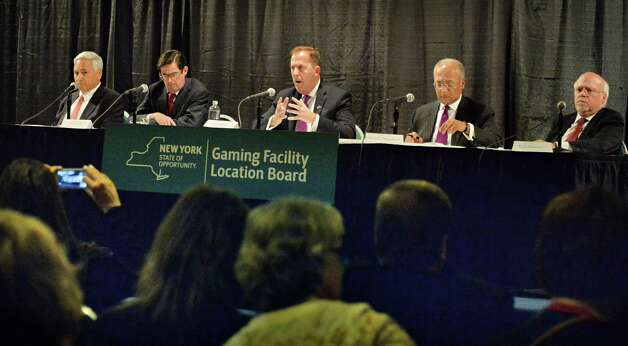 New York Gaming Facility Location Board members, from left, Dennis Glazer, Paul Francis, Chairman Kevin Law, William Thompson, Jr. and Stuart Rabinowitz during a meeting to announce their choices for casino sites Wednesday Dec. 17, 2014, in Albany, NY.   (John Carl D'Annibale / Times Union) Photo: John Carl D'Annibale / 00029888A