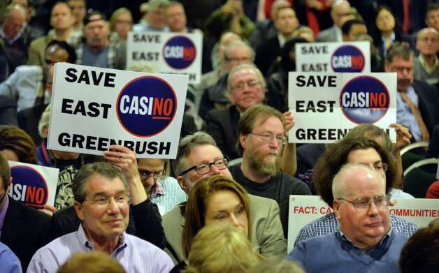 Opponents of an East Greenbush casino listen with bated breath as the New York Gaming Facility Location Board announces their choice for a Capital Region casino site during a meeting Wednesday Dec. 17, 2014, in Albany, NY.   (John Carl D'Annibale / Times Union) Photo: John Carl D'Annibale / 00029888A