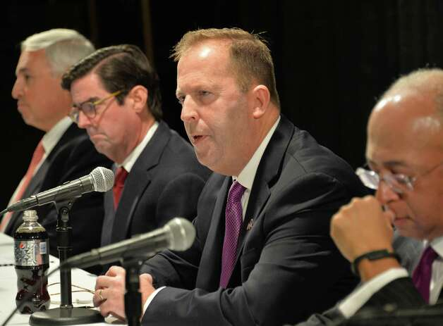 New York Gaming Facility Location Board Chairman Kevin Law, center, speaks during a meeting to announce their choices for casino sites Wednesday Dec. 17, 2014, in Albany, NY.   (John Carl D'Annibale / Times Union) Photo: John Carl D'Annibale / 00029888A