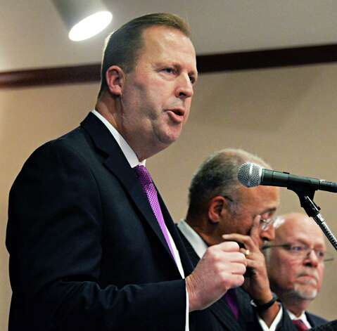 New York Gaming Facility Location Board Chairman Kevin Law, left, answers reporters questions at a news conference following the announcement of the board's choices for casino sites Wednesday Dec. 17, 2014, in Albany, NY.   (John Carl D'Annibale / Times Union) Photo: John Carl D'Annibale / 00029888A