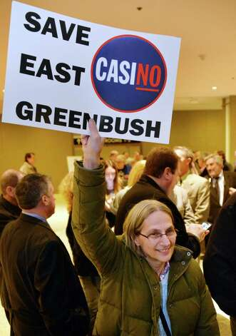 JoAnn Conway of East Greenbush waits in line for the beginning of the New York Gaming Facility Location Board's  meeting Wednesday Dec. 17, 2014, in Albany, NY.   (John Carl D'Annibale / Times Union) Photo: John Carl D'Annibale / 00029888A