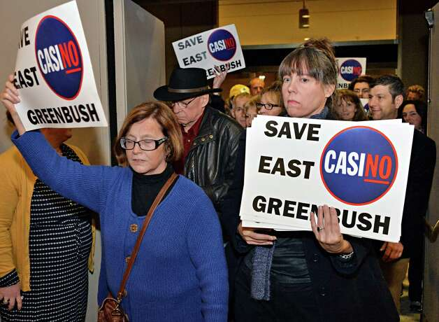 Opponents of the East Greenbush casino site pour into a meeting of the  New York Gaming Facility Location Board Wednesday Dec. 17, 2014, in Albany, NY.   (John Carl D'Annibale / Times Union) Photo: John Carl D'Annibale / 00029888A