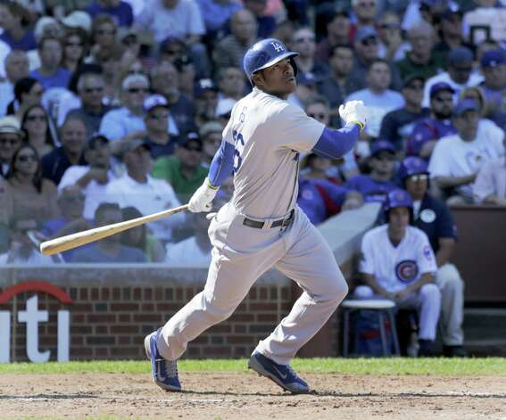 FILE - In this Sept. 19, 2014, file photo, Los Angeles Dodgers' Yasiel Puig doubles off a pitch from Chicago Cubs relief pitcher Eric Jokisch, during the fourth inning of a baseball game in Chicago. A South Florida businessman pleaded guilty Tuesday, Dec. 16, 2014, to taking part in a conspiracy to smuggle Dodgers star Yasiel Puig out of Cuba in return for a sizable cut of the outfielder's multimillion-dollar salary.(AP Photo/Charles Rex Arbogast, File) ORG XMIT: NY175 Photo: Charles Rex Arbogast / AP