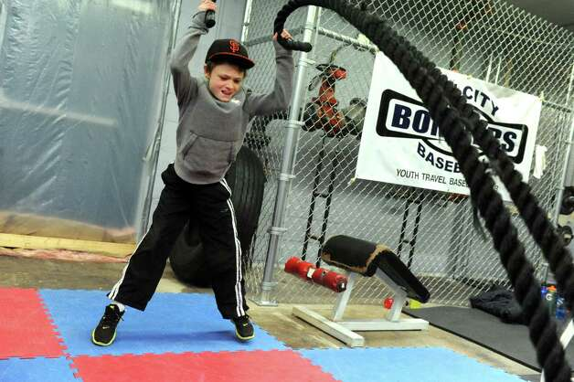 Little Bomber ten-year-old Calvin Lewis of Pittsfield, Mass warms up on the ropes during Tri City Bombers youth baseball training on Wednesday Dec. 17, 2014 in Troy ,N.Y.  (Michael P. Farrell/Times Union) Photo: Michael P. Farrell / 00029903A