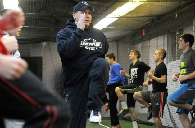 Coach, trainer and president of the Tri City Bombers Jamie Kosowsky leads his players in warm-ups during Tri City Bombers youth baseball training on Wednesday Dec. 17, 2014 in Troy ,N.Y.  (Michael P. Farrell/Times Union) Photo: Michael P. Farrell / 00029903A