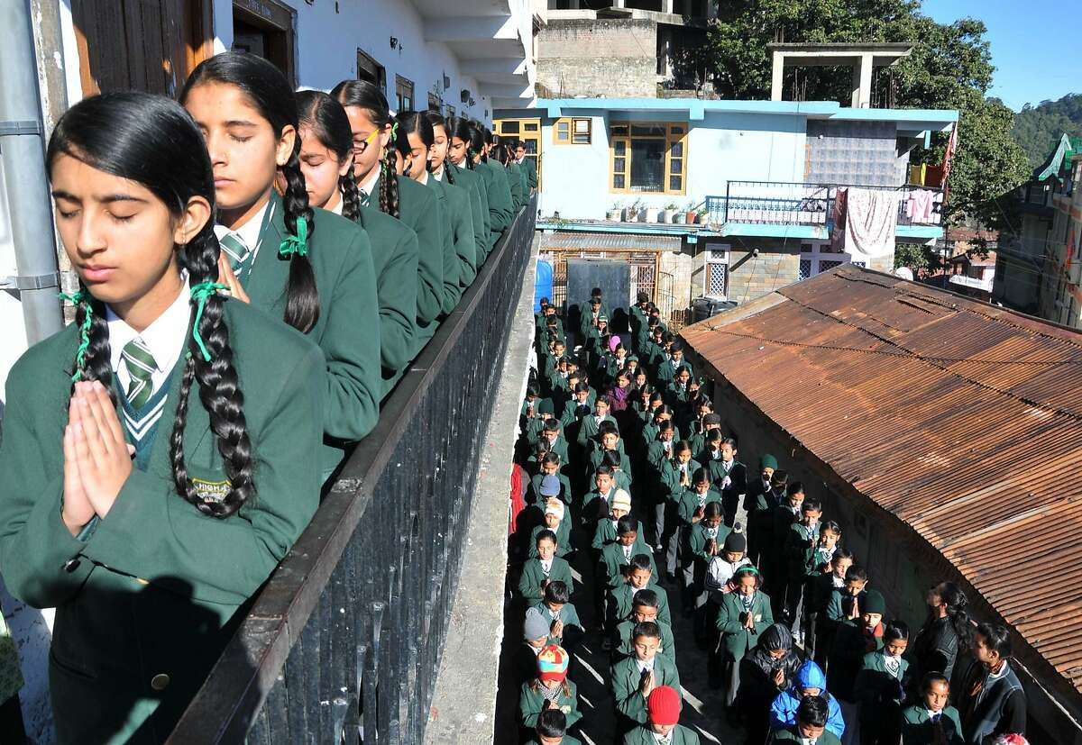 TOPSHOTS Indian schoolchildren pray during morning assembly at their school in Shimla on December 17, 2014, as they pay tribute to slain Pakistani schoolchildren and staff after an attack on an army school in the restive city of Peshawar. Pakistan began three days of mourning on December 17, for the 132 schoolchildren and nine staff killed by the Taliban in the country's deadliest ever terror attack as the world united in a chorus of revulsion. The 141 people were killed when insurgents stormed an army-run school in the northwestern city of Peshawar and systematically went from room to room shooting children during an eight-hour killing spree. AFP PHOTO/STRSTRDEL/AFP/Getty Images