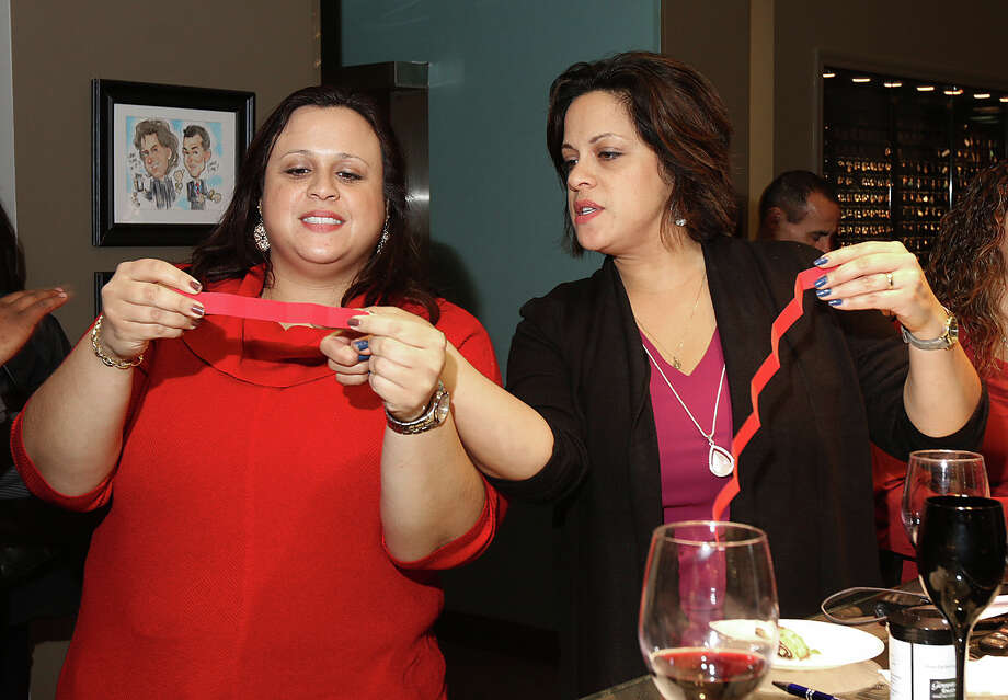Were you Seen at the Magic of the Holidays reception and toy drive, sponsored by the Capital District Hispanic Women and Centro Civico, Inc., at Glennpeter Jewelers in Colonie on Wednesday, Dec. 17, 2014? Photo: (C) JOE PUTROCK 2014, Joe Putrock/Special To The Times Union