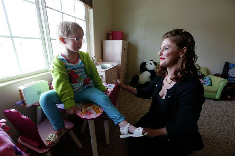FILE - In this April 29, 2014 file photo, Moriah Barnhart, a mother of a child with severe cancer, s
