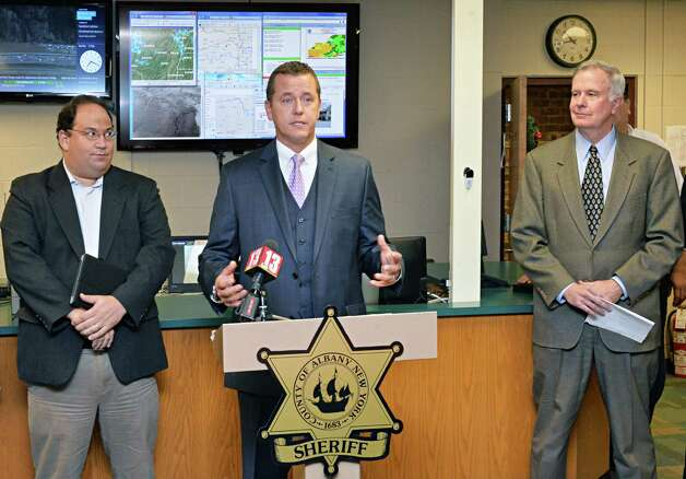 Albany County Sheriff  Craig Apple, center, is joined by Albany County deputy emergency manager Howard Altschule, left, and Bill Flaherty, National Grid Director of Community and Customer Management, during a news conference to announce a new weather monitoring station at the Albany County Sheriff Public Safety Building Wednesday Dec. 17, 2014, in Clarksville, NY. (John Carl D'Annibale / Times Union) Photo: John Carl D'Annibale / 00029892A