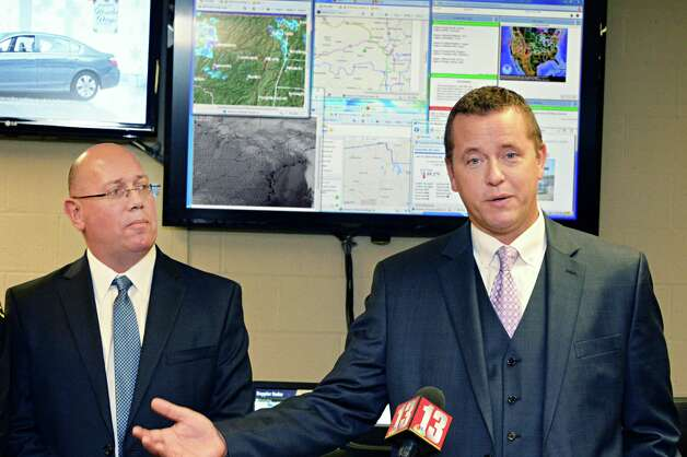 Albany County Sheriff  Craig Apple, right and Dennis Stewart of Earth Networks Ð WeatherBug Energy Solutions during a news conference to announce a new weather monitoring station at the Albany County Sheriff Public Safety Building Wednesday Dec. 17, 2014, in Clarksville, NY. (John Carl D'Annibale / Times Union) Photo: John Carl D'Annibale / 00029892A