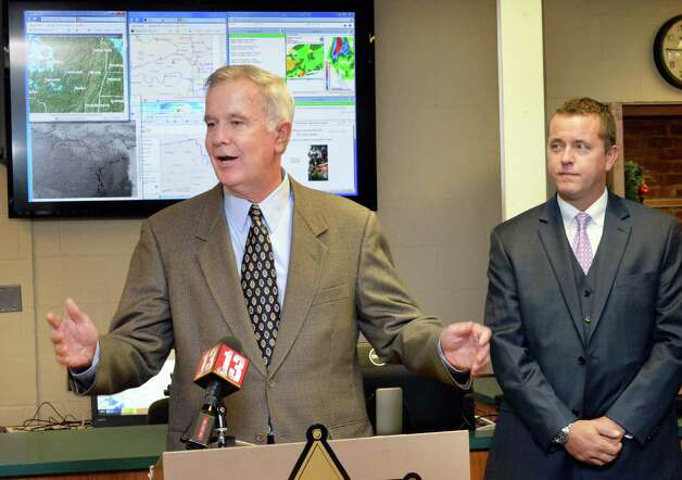 Bill Flaherty, left, National Grid Director of Community and Customer Management, speaks during a news conference for a new WeatherBug station at the Albany County Sheriff Public Safety Building Wednesday Dec. 17, 2014, in Clarksville, NY. At right is Albany County Sheriff Craig Apple. (John Carl D'Annibale / Times Union) Photo: John Carl D'Annibale / 00029892A
