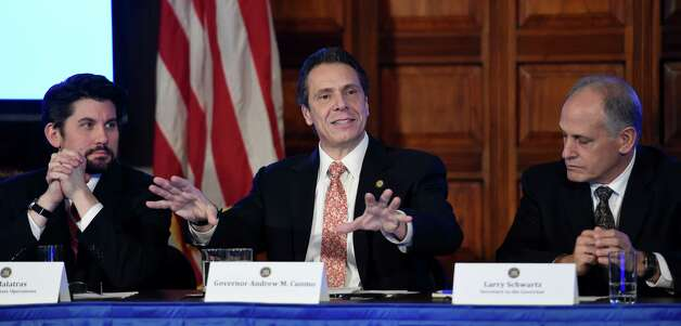 Governor Andrew Cuomo, center, surrounded by his cabinet members addressed numerous questions during his cabinet meeting held in the Red Room of the Capital Wednesday afternoon Dec. 17, 2014 in Albany, N.Y.     (Skip Dickstein/Times Union) Photo: SKIP DICKSTEIN / 00029897A