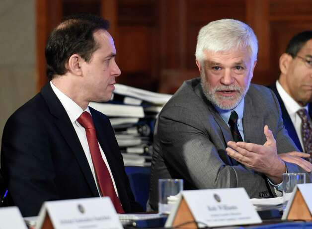 NYS DEC Commissioner Joe Martens, right,  gives his thoughts on fracking as acting Health Commissioner Howard Zucker looks on during the Governor's cabinet meeting held in the Red Room of the Capital Wednesday afternoon Dec. 17, 2014 in Albany, N.Y.     (Skip Dickstein/Times Union Photo: SKIP DICKSTEIN / 00029897A
