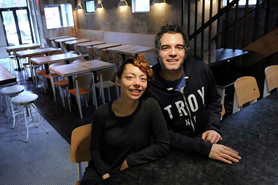Heather LaVine, left, and Vic Christopher in the first-floor reserved dining area on Wednesday Dec. 17, 2014, at The Tavern in Troy, N.Y. The husband and wife team will open their newest establishment on Jan. 7, 2015. (Cindy Schultz / Times Union) Photo: Cindy Schultz / 00029893A