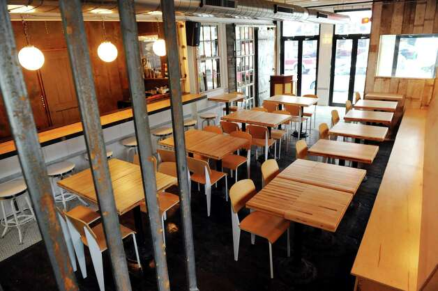 View of the dining room from the stairway on Wednesday Dec. 17, 2014, at The Tavern in Troy, N.Y. (Cindy Schultz / Times Union) Photo: Cindy Schultz / 00029893A