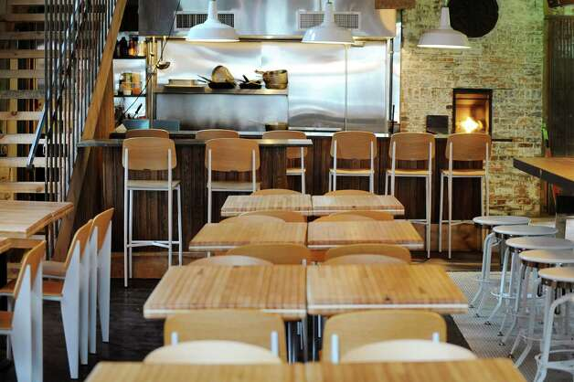 View of the dining room and open kitchen from the entrance on Wednesday Dec. 17, 2014, at The Tavern in Troy, N.Y. (Cindy Schultz / Times Union) Photo: Cindy Schultz / 00029893A