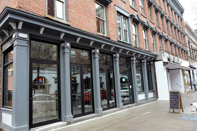 The Tavern, located at 217 Broadway, left, on Wednesday Dec. 17, 2014, in Troy, N.Y. Owners Vic Christopher and Heather LaVine will open their newest establishment on Jan. 7, 2015. (Cindy Schultz / Times Union) Photo: Cindy Schultz / 00029893A