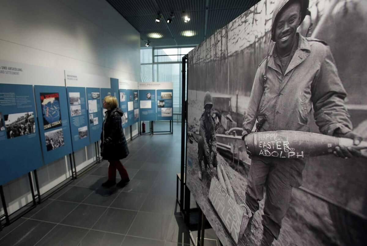 """A visitor looks at pictures of the exhibit """"Germany 1945, The Last Months of the War"""" at the Topography of Terror Museum in Berlin. The exhibition marks next year's 70th anniversary of the end of World War II."""