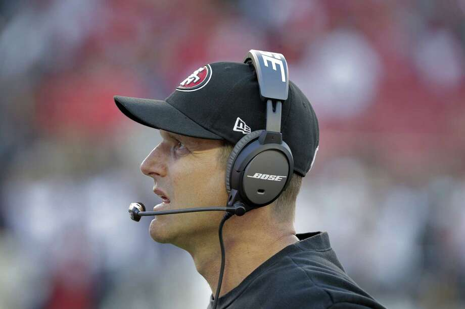 49ers head coach Jim Harbaugh watches the replay of the last play before it was ruled a fumble at the end of the second half as San Francisco played the St. Louis Rams in Santa Clara. The 49ers lost 13-10. Photo: Carlos Avila Gonzalez / The Chronicle / ONLINE_YES