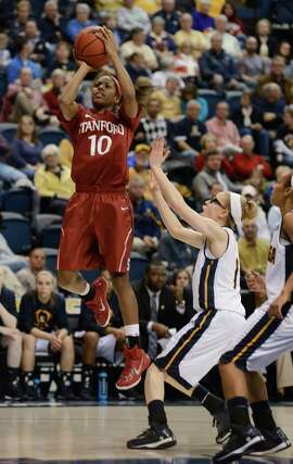 Stanford's Briana Roberson (10) shoots against Chattanooga's Alicia Payne (1) during the first half of an NCAA college basketball game Wednesday, Dec. 17, 2014, in Chattanooga, Tenn. (AP Photo/Billy Weeks)