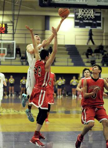 Troy's Zach Radz drives to the basket during their boy's high school basketball game against Albany Academy on Wednesday Dec. 17, 2014 in Troy ,N.Y.  (Michael P. Farrell/Times Union) Photo: Michael P. Farrell / 00029859A