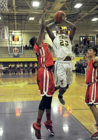 Troy's Maurice Watson drives to the basket during their boy's high school basketball game against Albany Academy on Wednesday Dec. 17, 2014 in Troy ,N.Y.  (Michael P. Farrell/Times Union) Photo: Michael P. Farrell / 00029859A