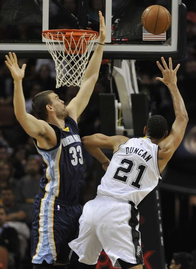 San Antonio Spurs forward Tim Duncan, right, shoots against Memphis Grizzlies center Marc Gasol, of Spain, during the first half of an NBA basketball game, Wednesday, Dec. 17, 2014, in San Antonio. (AP Photo/Darren Abate) Photo: Associated Press