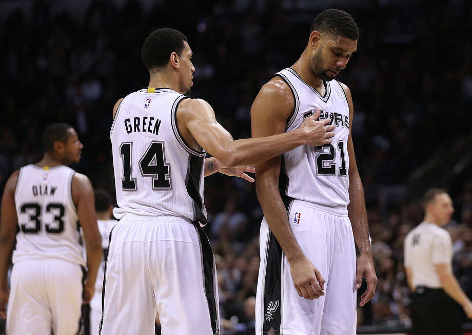 As was the case Wednesday, the Spurs' Boris Diaw (33), Danny Green (14) and Tim Duncan will be without Kawhi Leonard and Tony Parker today vs. Portland. Photo: Jerry Lara /San Antonio Express-News / © 2014 San Antonio Express-News