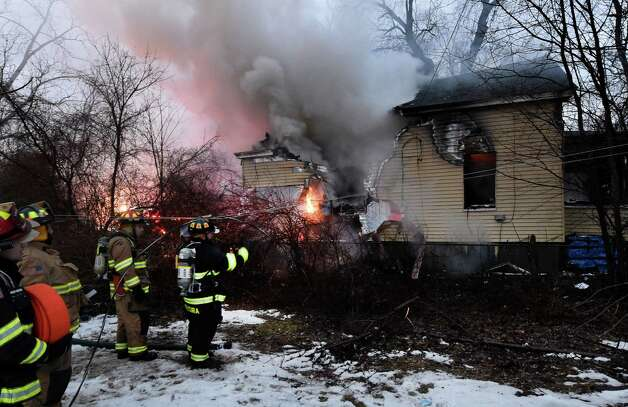 Fire consumes a home at 10 Grenada Terrace this morning Dec. 18, 2014 in Watervliet, N.Y.  There were no injuries. (Skip Dickstein/Times Union) Photo: SKIP DICKSTEIN