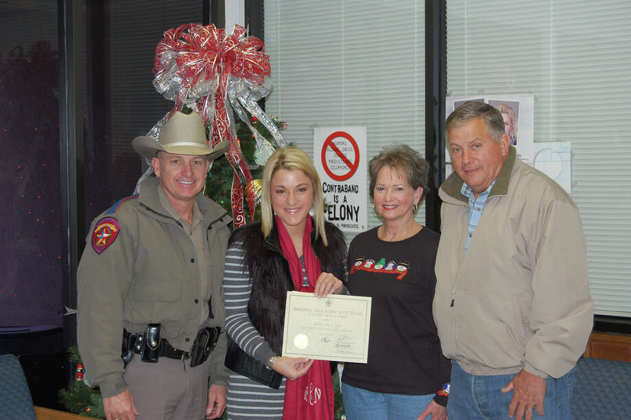 From L-R BeauClark, Ashley Clark, Cynthia Clark, Sheriff Mitchel Newman awarding the scholarship. photo by Jeff Reedy