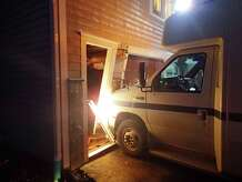 This van rammed the garage on the lower level of a Terhune Drive home after dropping of a passenger Wednesday.